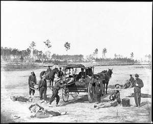 Zouave ambulance crew demonstrating removal of wounded soldiers from the field. Unknown date and location.