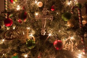 christmas tree ornaments, including cross. niles i wonder as I wander